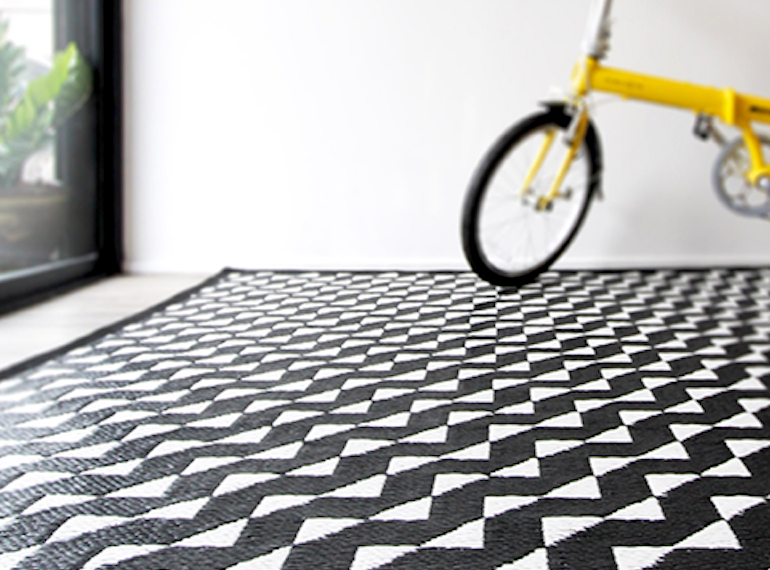 Hit up Hit Van for stylish rugs at a steal. We've got our eyes on this Stride indoor/outdoor mat by PDM Brand, for just $159.