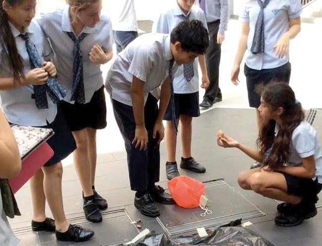 Completing a STEM challenge together at GEMS World Academy.