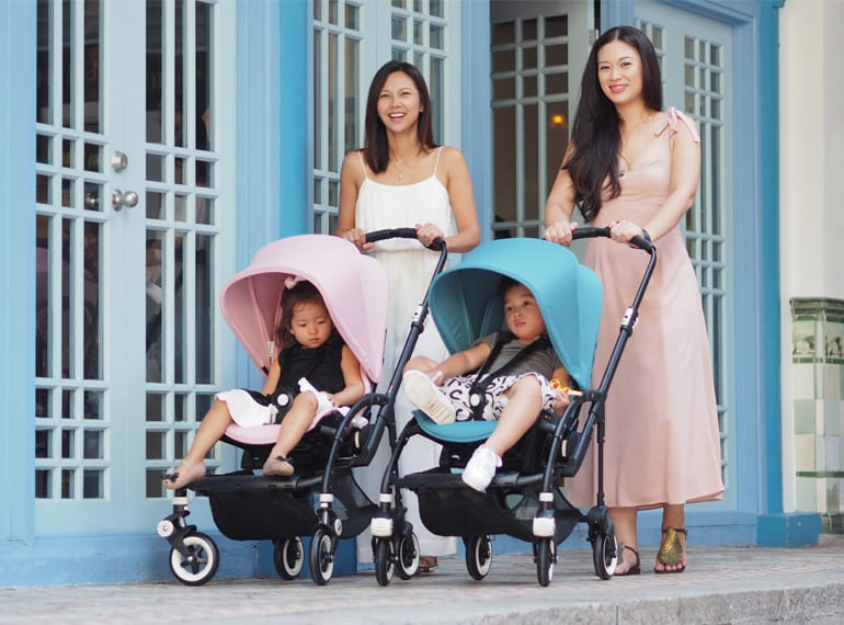 Belinda and Tjin with kids rocking the soft pink and petrol blue Bugaboo Bee 3 strollers - the perfect compact pram for zipping around Singapore with little ones.