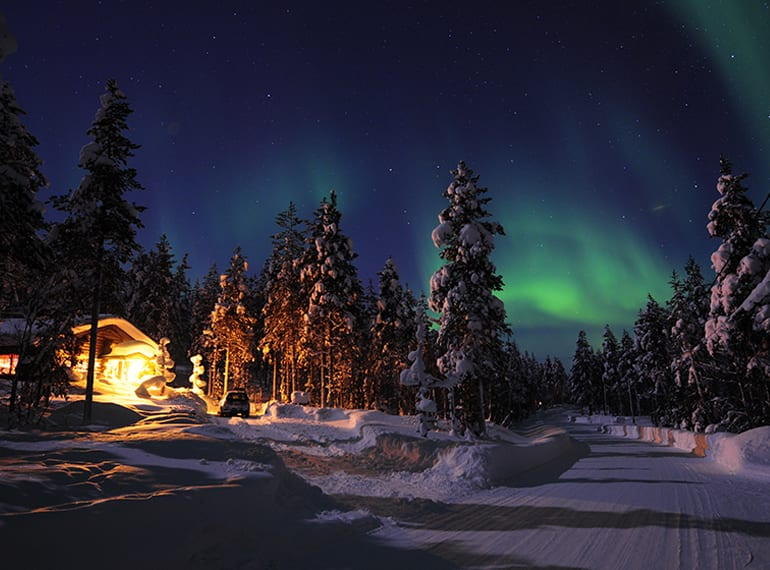 Head to the Arctic Circle and cross meeting Santa and seeing the Northern Lights off your bucket list.