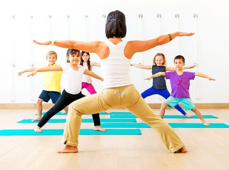 Salute the sun at one of the best yoga classes for kids in Singapore!