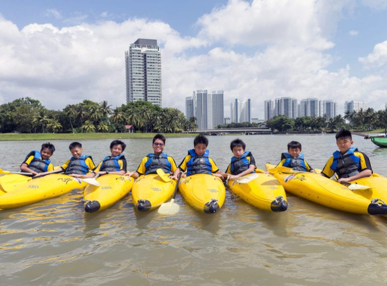 Water sports for kids in Singapore: kayaking, surfing, dragon boating and sailing
