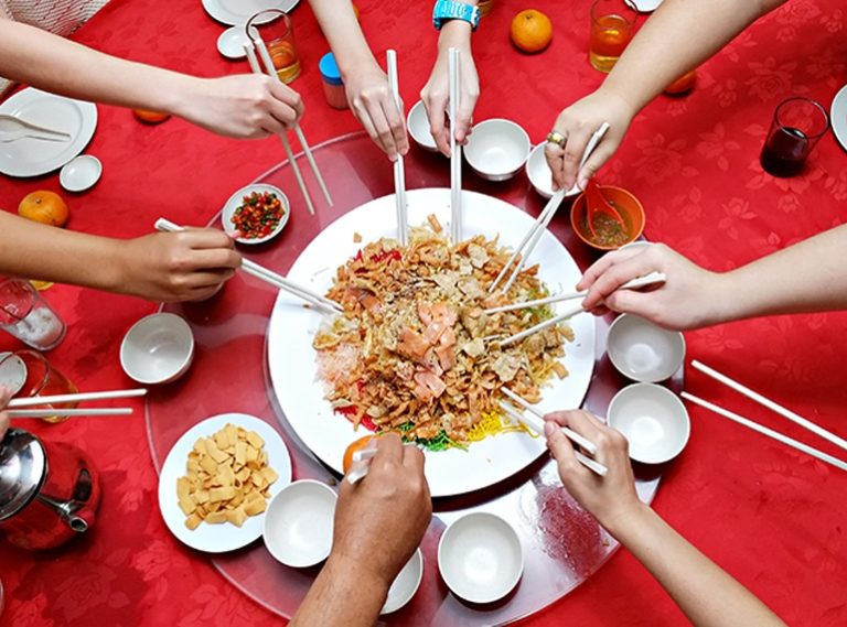 How and why we toss our lo hei at Chinese New Year: a beginner's guide to yusheng in Singapore