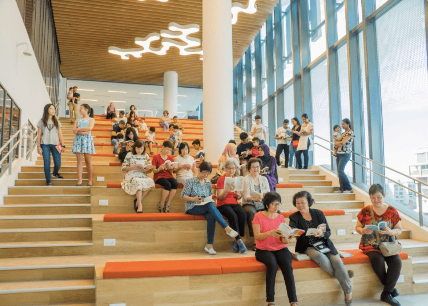 people sitting on the steps at tampines library