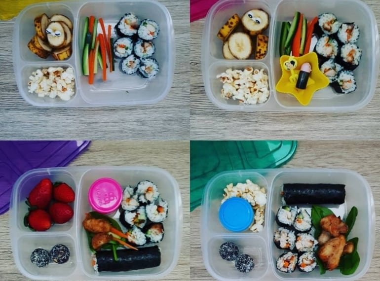 Top view of kids lunchbox, sushi, popcorn, healthy snacks - kids lunchbox ideas
