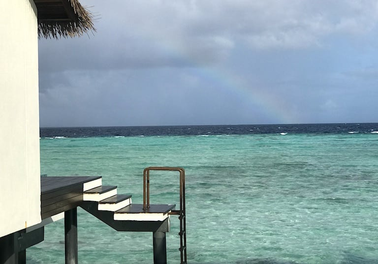 Rainbow spotting from the overwater bungalows at The Residence Maldives.