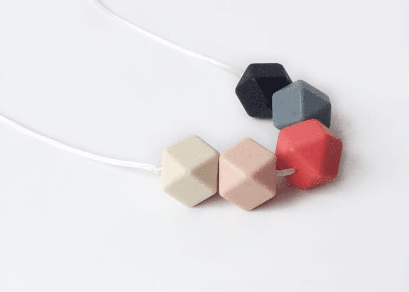 hexagonal necklace on table
