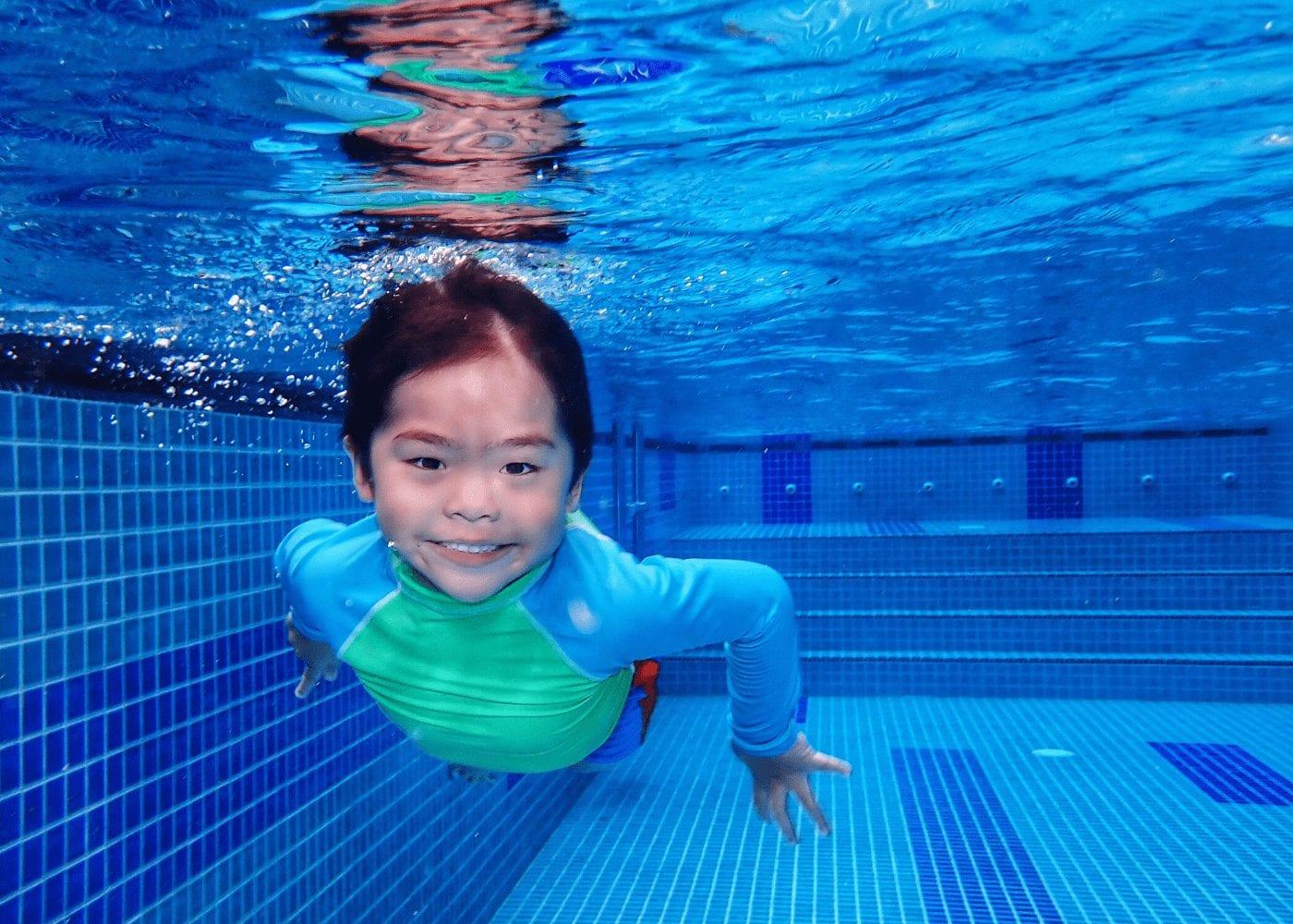 kid-swimming-in-pool