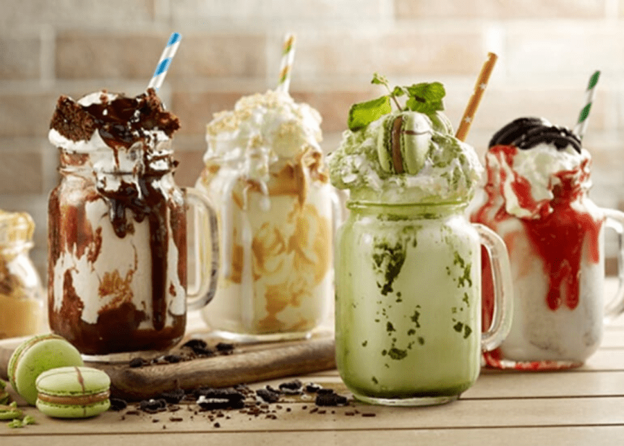 four different milkshakes on the table