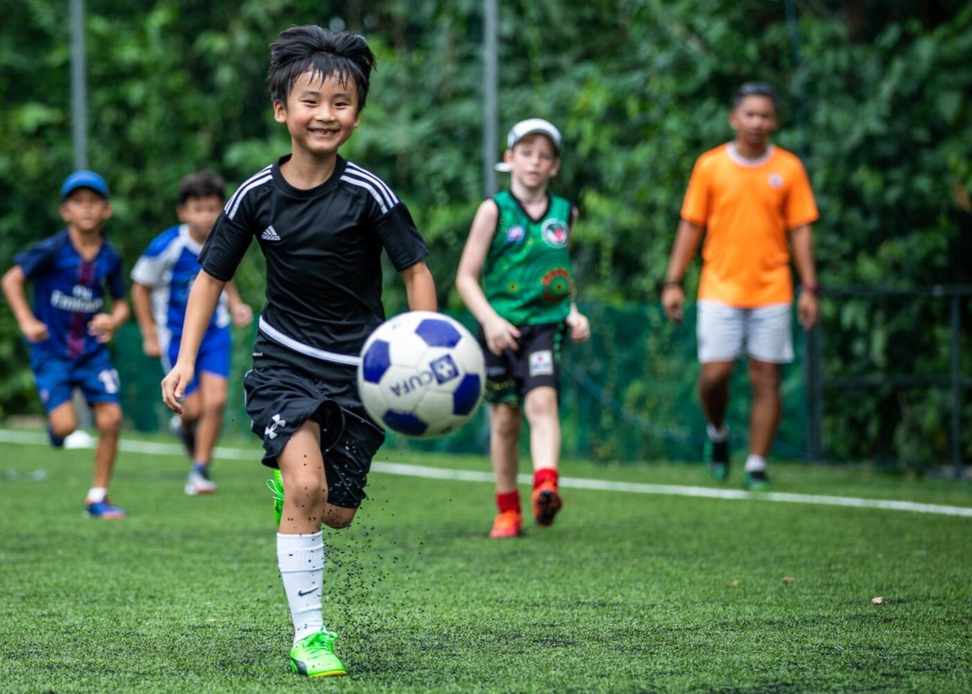 kid running towards the ball