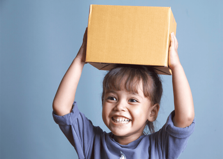 girl holding a box over her head